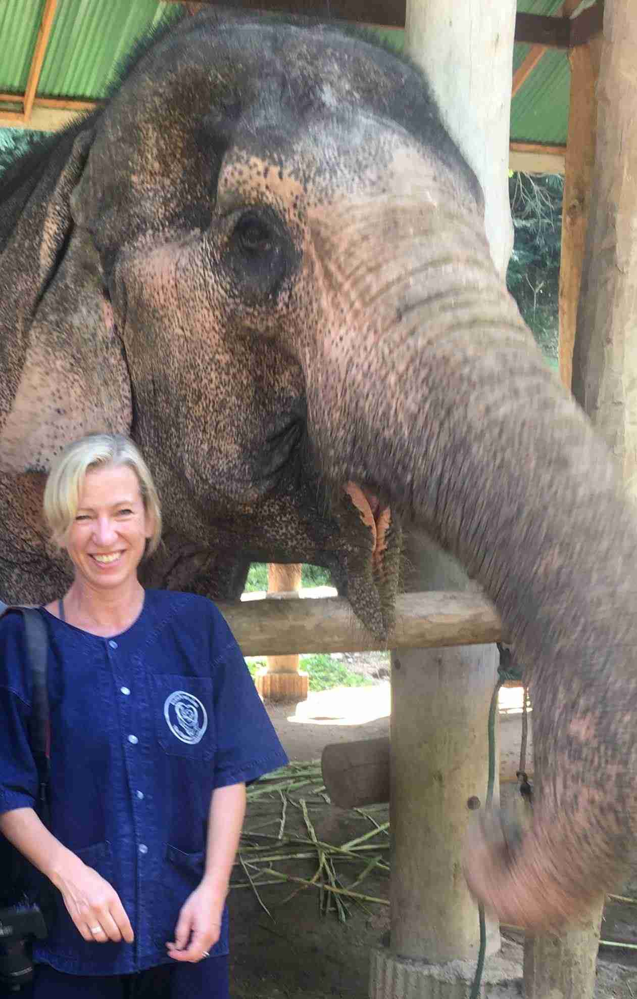 Louise standing next to an elephant