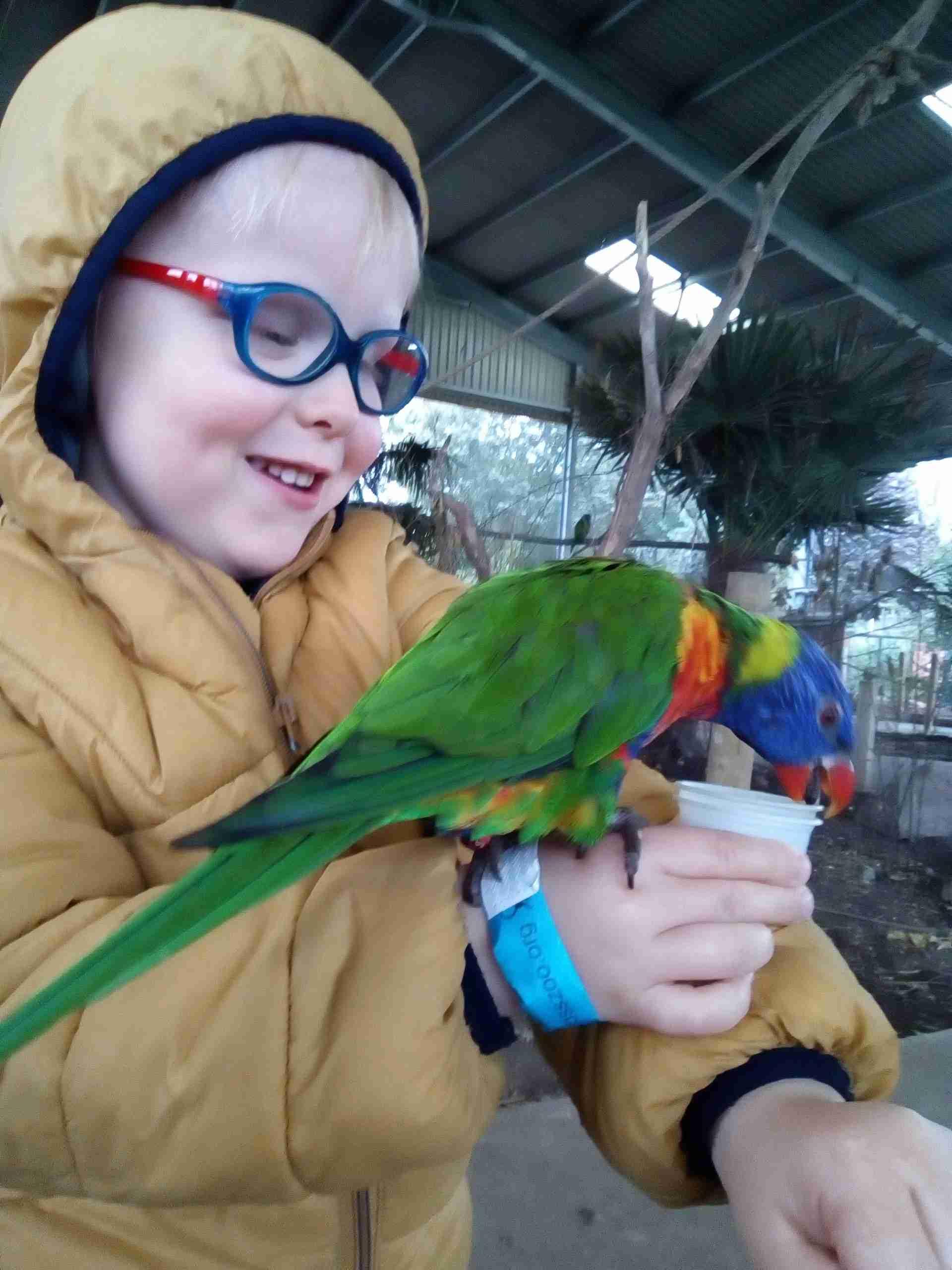 Larsen holding a parrot