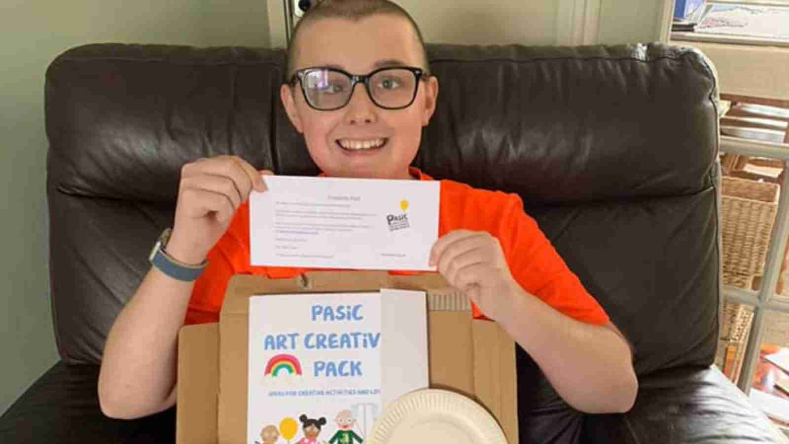 Matty smiling with his creativity pack
