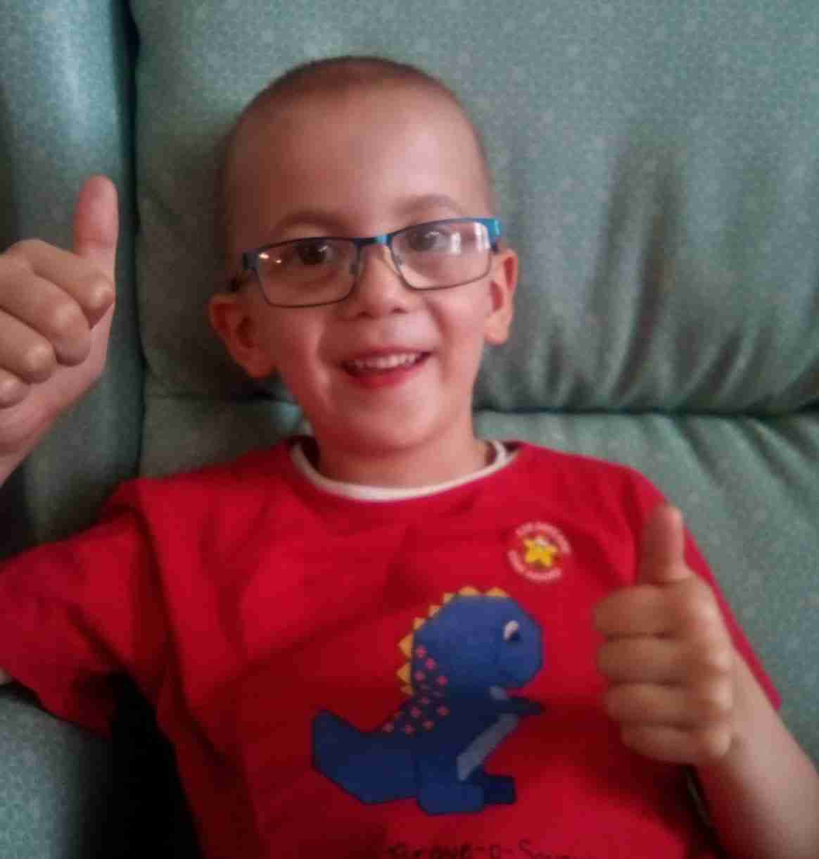Evan with his thumbs up